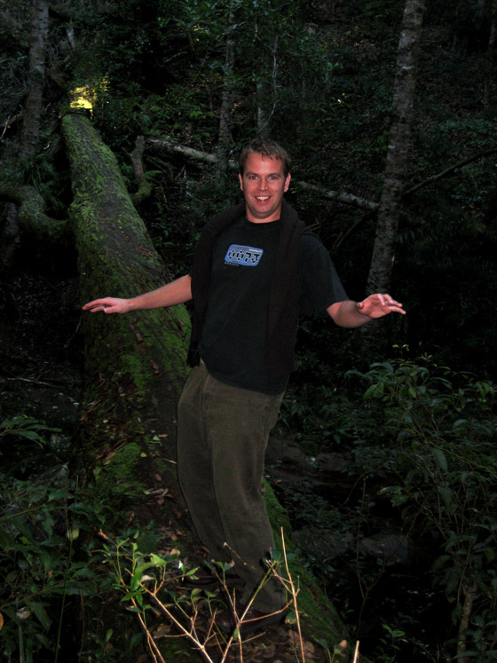 Stu balancing on a fallen tree